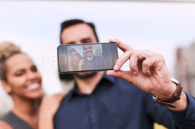Buy stock photo Closeup shot of two colleagues taking a selfie together outside an office
