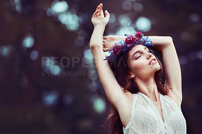 Buy stock photo Shot of a beautiful young woman wearing a floral head wreath outdoors