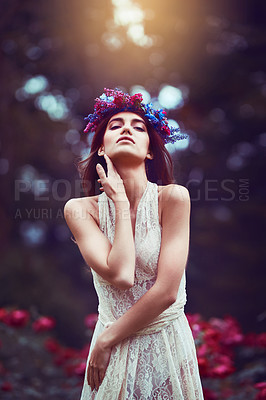 Buy stock photo Portrait of a beautiful young woman wearing a floral head wreath outdoors