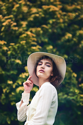 Buy stock photo Shot of a beautiful young woman spending a day in nature