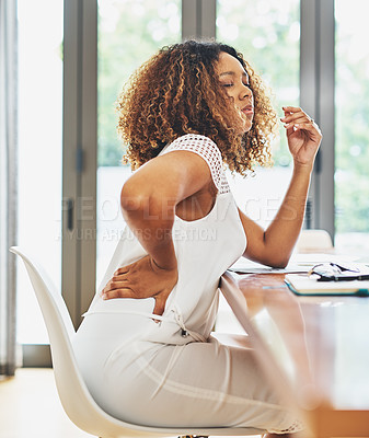 Buy stock photo Cropped shot of a young attractive businesswoman experiencing body discomfort in her office at home