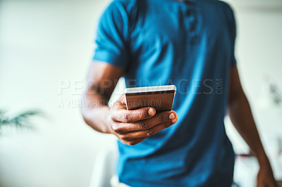 Buy stock photo Closeup shot of an unrecognizable man using a cellphone