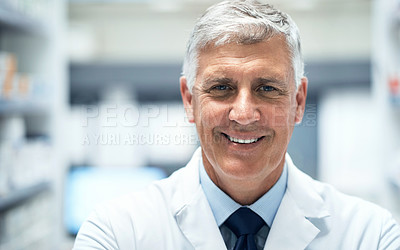 Buy stock photo Cropped portrait of a mature male pharmacist working in a dispensary