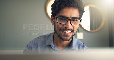 Buy stock photo Cropped shot of a handsome young businessman working at home