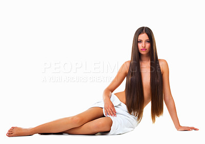 Buy stock photo Studio portrait of a young woman with long silky hair against a white background