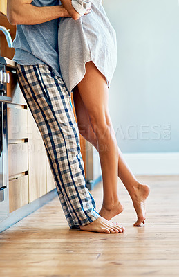 Buy stock photo Closeup shot of an unrecognizable couple bonding together at home
