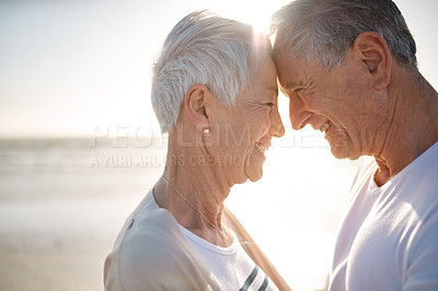 Buy stock photo Shot of a senior married couple at the beach