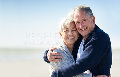 Buy stock photo Portrait of a happy senior couple embracing at the beach