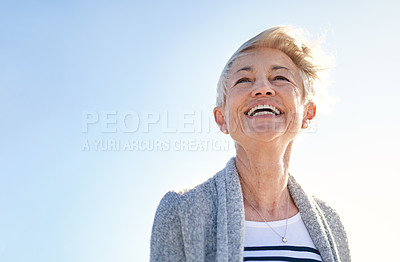 Buy stock photo Shot of a happy senior woman spending a day outdoors