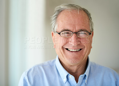 Buy stock photo Shot of a happy senior man at home
