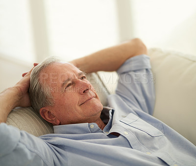 Buy stock photo Shot of a senior man enjoying a relaxing break on the sofa at home