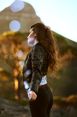 Buy stock photo Shot of an attractive and stylish young woman spending some time outdoors