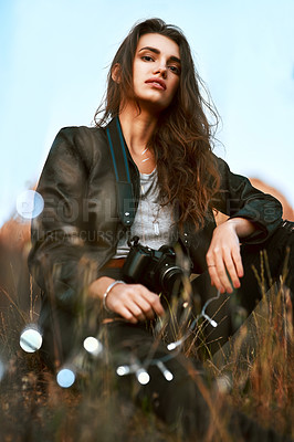Buy stock photo Portrait of an attractive and stylish young woman spending some time outdoors