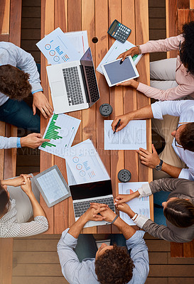 Buy stock photo High angle shot of a group of businesspeople having a meeting outdoors