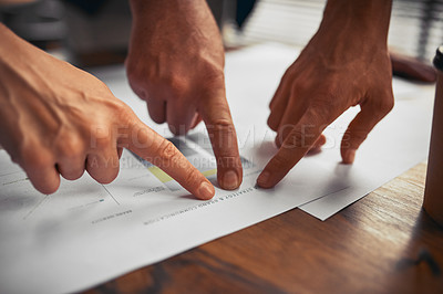 Buy stock photo Cropped shot of unrecognizable businesspeople working on paperwork together in the office