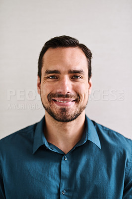Buy stock photo Portrait of a handsome young businessman standing in an office