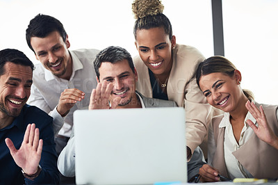Buy stock photo Shot of a group of businesspeople having a video conference together on a laptop in an office
