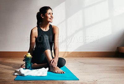 Buy stock photo Shot of an attractive young woman taking a break while exercising at home