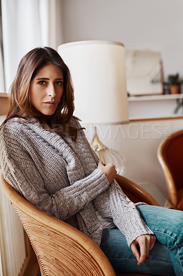 Buy stock photo Portrait of an attractive young woman relaxing on a chair at home