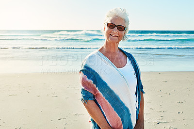 Buy stock photo Cropped portrait of a senior woman visiting the beach on a summer's day