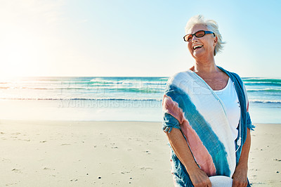 Buy stock photo Cropped shot of a senior woman visiting the beach on a summer's day