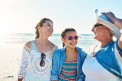 Buy stock photo Cropped shot of a senior woman spending the day at the beach with her daughter and granddaughter