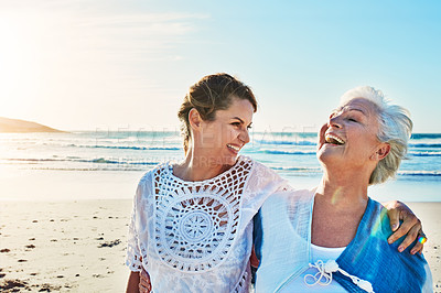 Buy stock photo Cropped shot of a senior woman and her adult daughter spending a day at the beach