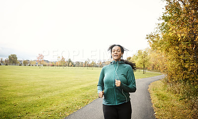 Buy stock photo Portrait of an attractive young woman going for a run in nature