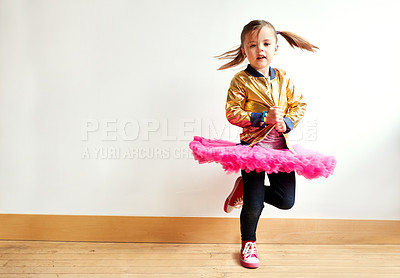 Buy stock photo Shot of a little girl dancing in a dance studio