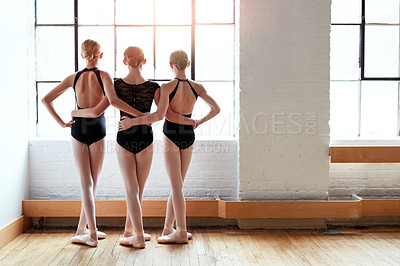 Buy stock photo Shot of a group of young girls practicing ballet together in a dance studio