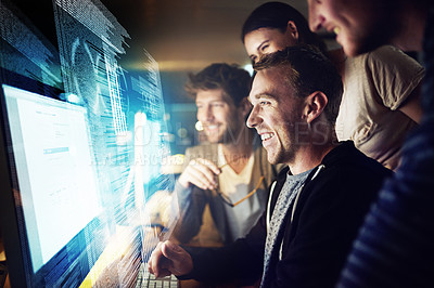 Buy stock photo Shot of a group of programmers working on a computer code at night