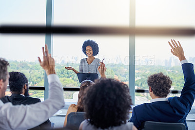 Buy stock photo Shot of a young businesswoman answering questions during a presentation in an office