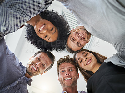 Buy stock photo Portrait of a group of businesspeople putting their heads together in a huddle