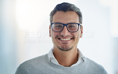 Buy stock photo Portrait of a handsome young businessman in an office