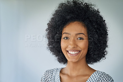 Buy stock photo Portrait of a confident young businesswoman against a grey background