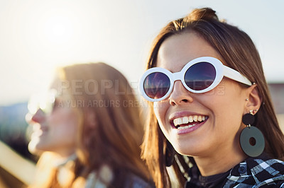 Buy stock photo Cropped portrait of two attractive young women spending the day outdoors