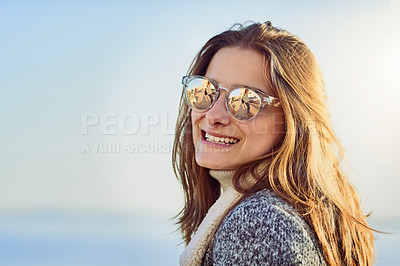 Buy stock photo Cropped portrait of an attractive young woman spending a day by the ocean
