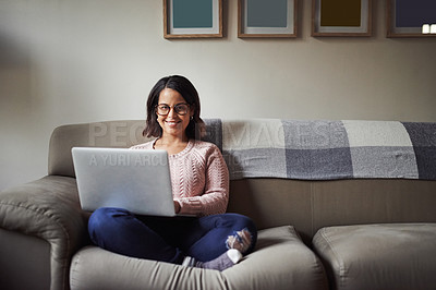 Buy stock photo Portrait of an attractive young woman using a laptop at home