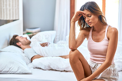 Buy stock photo Shot of a young couple having marital problems in the bedroom at home