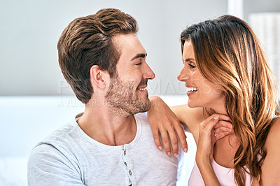 Buy stock photo Shot of a loving young couple spending a relaxing morning at home