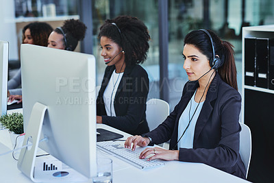 Buy stock photo Shot of young women working in a call centre