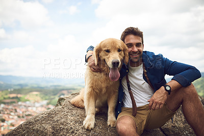 Buy stock photo Cropped portrait of a handsome young man and his dog taking a break during a hike in the mountains