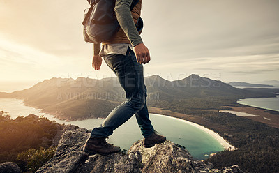 Buy stock photo Rearview shot of an unrecognizable young man hiking through the mountains