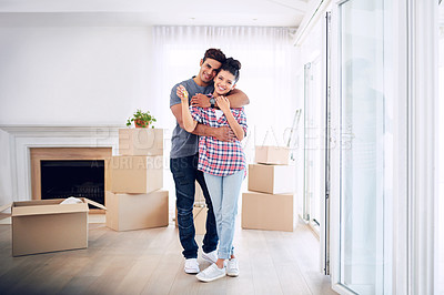 Buy stock photo Portrait of a young couple holding the keys to their new house