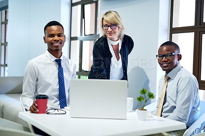 Buy stock photo Portrait of a group of businesspeople working together on a laptop in an office