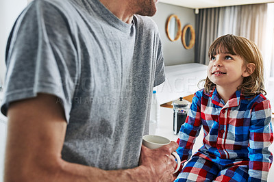 Buy stock photo Cropped shot of an unrecognizable father and his young son in the kitchen at home
