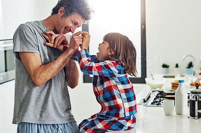 Buy stock photo Cropped shot of a mature father and his young son in the kitchen at home