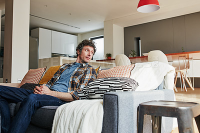 Buy stock photo Cropped shot of a handsome mature man relaxing on the sofa at home