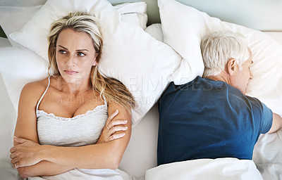 Buy stock photo Shot of a mature couple having marital problems at home