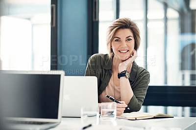 Buy stock photo Portrait of an attractive young businesswoman working at her desk in an office
